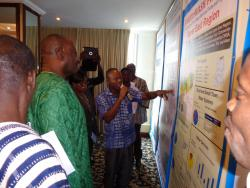 Honourable Dr.  Kwaku Agyemang Mensah, Minister of Water Resources,  Works and Housing, takes a tour along the posters showing the data of the participating regions