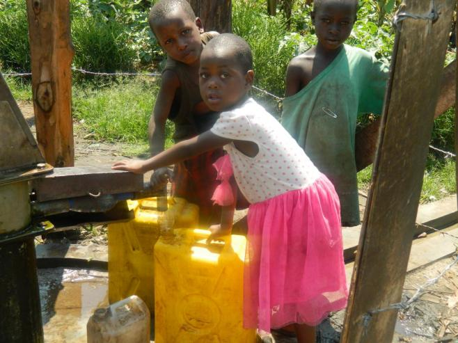 Children at Kasenyi borehole in Kabarole Uganda