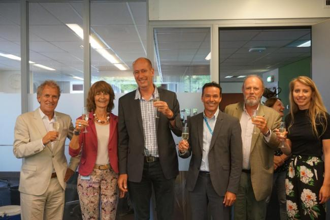 IRC and DGIS staff celebrate new partnership.