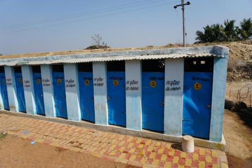 Personal latrines with a lock on the community ground in Ganjam district