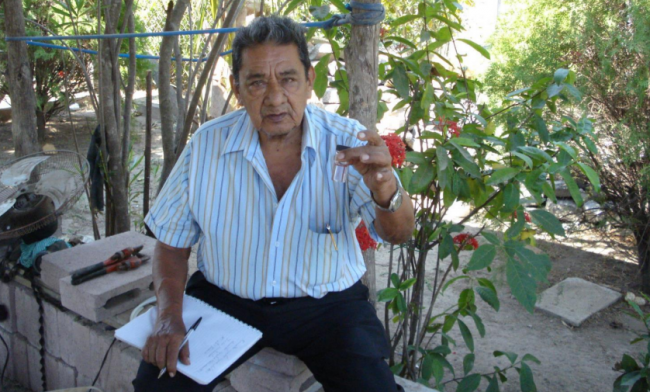 The chair of a water committee in El Salvador checks water quality