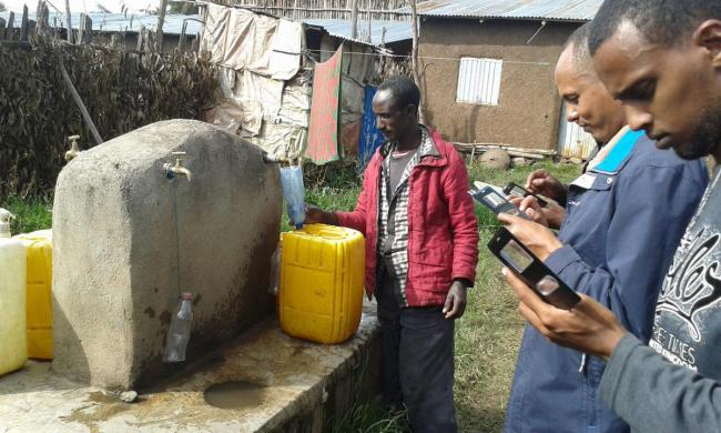 Using mobile phones to collect baseline data in Ethiopia. Photo