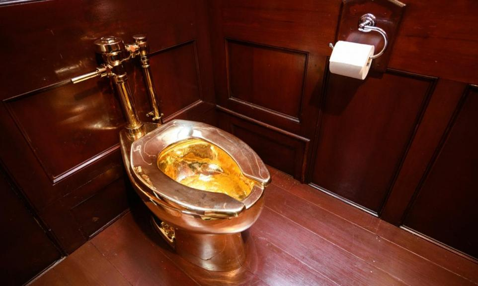 Golden toilet by Maurizio Cattelan (photo copyright Leon Neal/Getty Images)