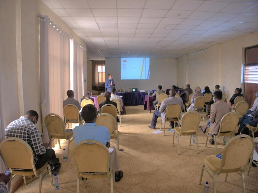 Participants of the workshop listening to Lemessa Mekonta, IRC Ethiopia country director