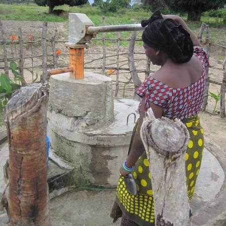 Woman using a rural water pump