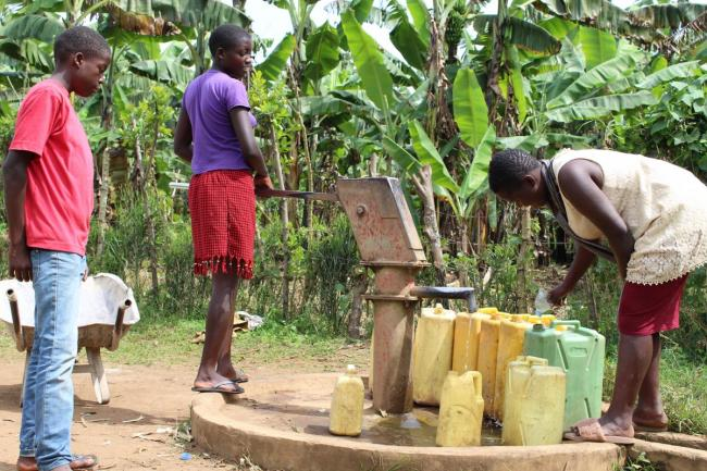 Siblings fetching water in Kabarole District