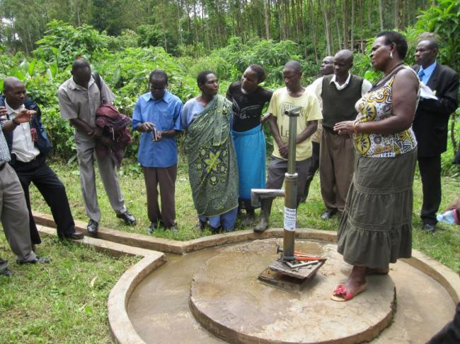Visiting a community water point in Kabarole District