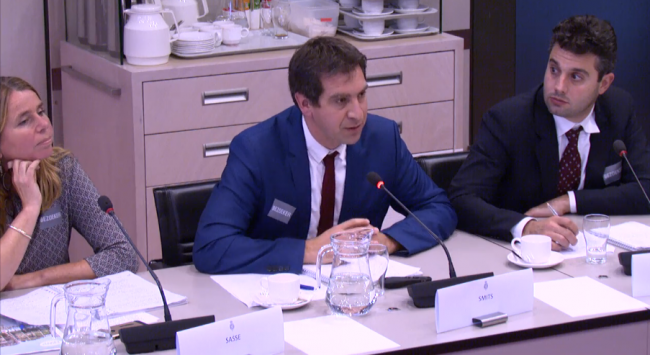 IRC's Stef Smits (centre) presents his case to Dutch Members of Parliament, flanked by Rolien Sasse (left) and Giacomo Galli (right). Screenshot livestream
