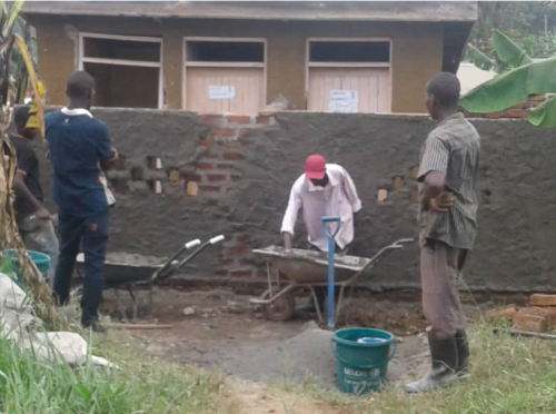 KAHASA working on curtain wall of latrines at a health centre (IRC Uganda)