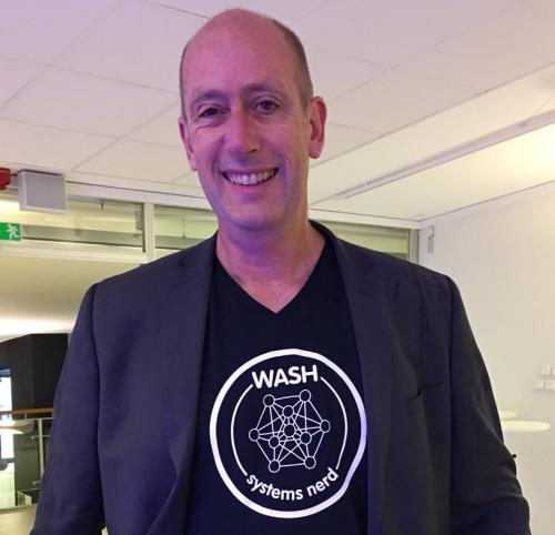IRC's CEO Patrick Moriarty wearing a WASH systems nerd t-shirt