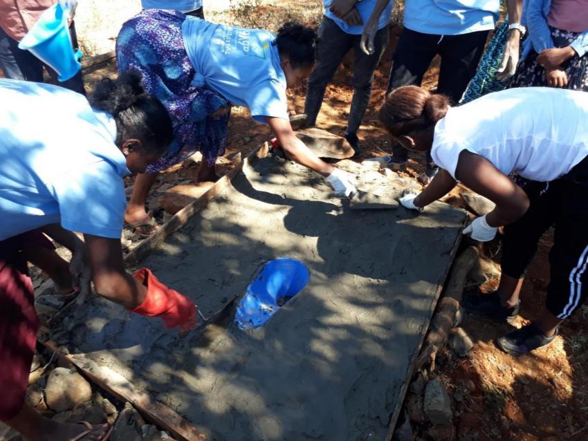 Women installing SaTo pan in Ethiopia (photo by Ayatam Simeneh from PSI Ethiopia)