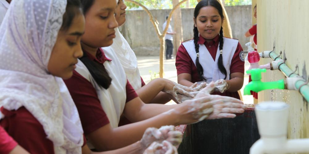 Girls washing hands at Mohamuni Anglo Pali High School, Mohamuni, Pahartali, Rauzan, Chittagong, Bangladesh