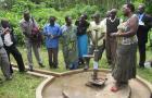 examining broken pump in Uganda