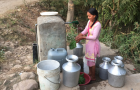 Woman collecting water at tap stand