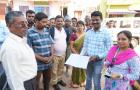 Gram Panchayat officials and the Village Water and Sanitation Committee with the tariff collection registration
