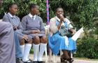 IRC Uganda's Lydia Mirembe with secondary school students, in a discussion about menstrual hygiene management