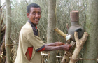 Community leader proudly showing off his new tippy tap, Amhara, Ethiopia by Julia Rosenbaum