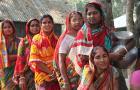 Bangladeshi women standing in line for water