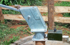 Lockable handle and water metre protected with box to provide security and control on Pay as you fetch borehole.
