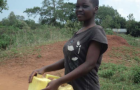 Woman fetching water in Uganda