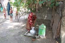 Woman fetching water in Bangladesh