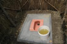 Latrine with pink footsteps in India