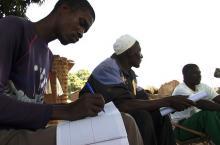 Man writing down notes in Burkina Faso