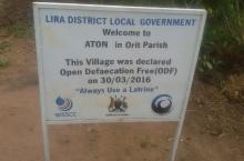 A signpost that welcomes visitors to Aton ODF village