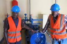 Maintenance men near water supply service in Rwanda (photo Stef Smits)