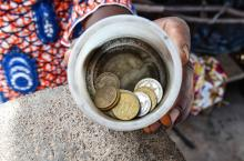 Small jar with money at market in Burkina Faso