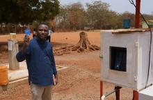 Festus Boadi at the automated water collection point in Kenyasi No 2