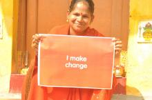 "Indian lady holding up sign ""I make change"""