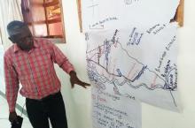 Explaining all the activities around river Mpanga (photo Arjen Naafs)