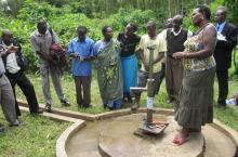 examining broken pump in Uganda