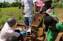 Men checking out a pump in Lira Uganda