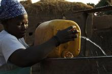 Woman fetching water in Hounde Burkina Faso