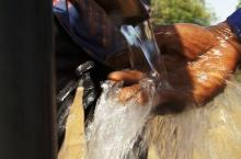 Water running from pump in Burkina Faso