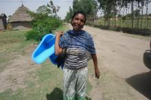 Abeba conducting door – to –door promotion  for one of Transform WASH's improved  sanitation product - SATO pan