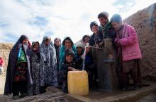 Children at a water pump in Afghanistan, photo by Rosanna Keam