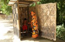 Family testing latrine in Bangladesh