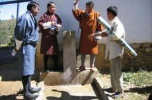 Men around a tap in Bhutan