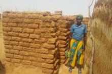 Burkina Faso - woman and latrine