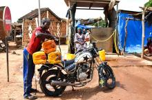 Transporting water with a motorcycle in Burkina Faso