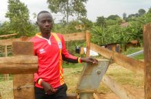 James Mujuni at Mugusu market borehole