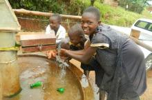 Children enjoy fresh water from a newly rehabilitated borehole in Kabarole district