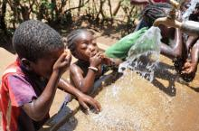 Happy children in Ethiopia enjoying water