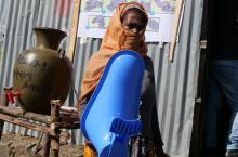 Woman at shop for toilet parts in Ethiopia