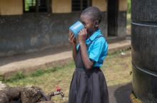 Girl drinking water in Fort Portal, Uganda