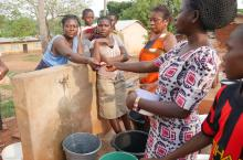 Gloria Badu collects payments at a private tap-stand in Wamahinso, Asutifi North
