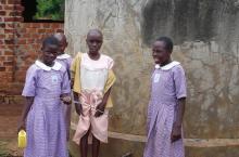 Ugandan girls at water tank